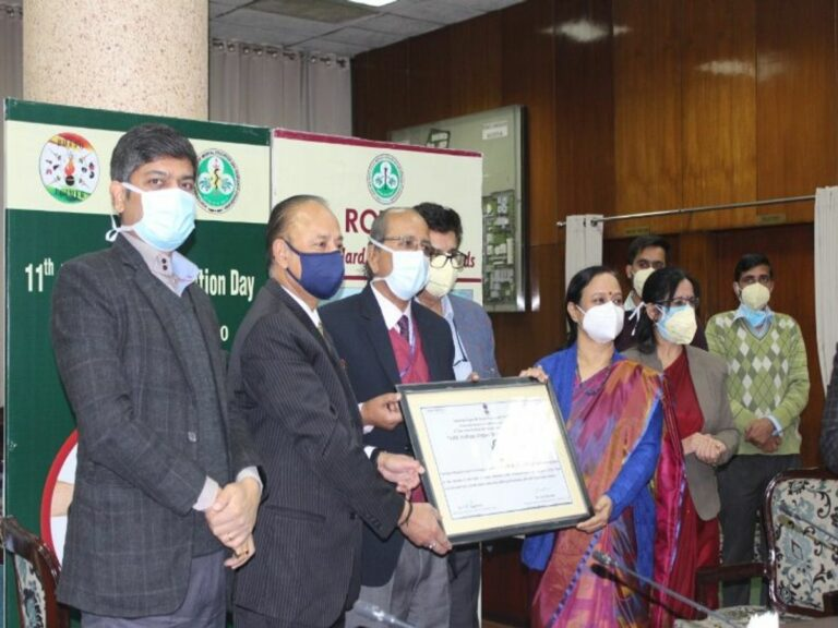 Medical professional getting awarded at a ceremony.